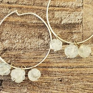 handmade hoop earrings with carved quartz stone